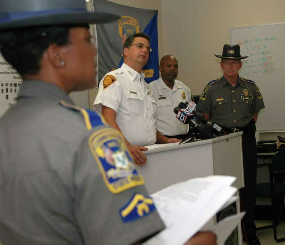 Bridgeport police chief Joseph Gaudett Jr.addresses the media at a press conference at State Police Troop G barracks on Wednesday June 29, 2011.  With Gaudett is Stratford interim chief Patrick Ridenhauer and State police commander Danny Stebbins. Bridgeport, Stratford and state police raided eight homes in Bridgeport and Stratford early Wednesday morning, arresting 29 suspected gang members in a wide-ranging drug and gun sweep. State police spokesman Lt. J. Paul Vance said the raids were the result of an investigation that began in March 2010. Photo: Cathy Zuraw / Connecticut Post