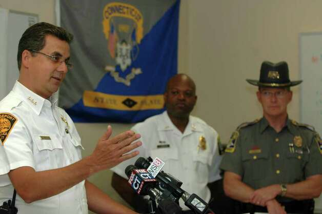 Bridgeport police chief Joseph Gaudett Jr. addresses the media at a press conference at State Police Troop G barracks on Wednesday June 29, 2011. With Gaudett is Stratford interim chief Patrick Ridenhauer and State police commander Danny Stebbins. Bridgeport, Stratford and state police raided eight homes in Bridgeport and Stratford early Wednesday morning, arresting 29 suspected gang members in a wide-ranging drug and gun sweep. State police spokesman Lt. J. Paul Vance said the raids were the result of an investigation that began in March 2010. Photo: Cathy Zuraw / Connecticut Post