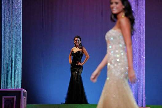 Miss San Antonio Domonique Ramirez, center, competes in the evening gown portion during the first night of the Miss Texas Pageant preliminary competition at Texas Hall on the campus of the University of Texas at Arlington on Tuesday, June 28, 2011. LISA KRANTZ/lkrantz@express-news.net Photo: LISA KRANTZ, SAN ANTONIO EXPRESS-NEWS / SAN ANTONIO EXPRESS-NEWS