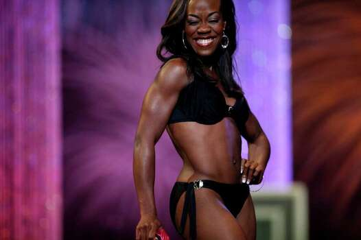 Selina Affram, Miss Collegiate San Antonio, competes in the fitness portion during the first night of the Miss Texas Pageant preliminary competition at Texas Hall on the campus of the University of Texas at Arlington on Tuesday, June 28, 2011. LISA KRANTZ/lkrantz@express-news.net Photo: LISA KRANTZ, SAN ANTONIO EXPRESS-NEWS / SAN ANTONIO EXPRESS-NEWS