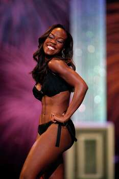 metro - Selina Affram, Miss Collegiate San Antonio, competes in the fitness portion during the first night of the Miss Texas Pageant preliminary competition at Texas Hall on the campus of the University of Texas at Arlington on Tuesday, June 28, 2011. LISA KRANTZ/lkrantz@express-news.net Photo: LISA KRANTZ, SAN ANTONIO EXPRESS-NEWS / SAN ANTONIO EXPRESS-NEWS