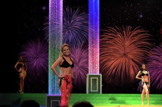 metro - Jennifer Peter, Miss East Texas and a San Antonio resident, competes in the fitness portion during the first night of the Miss Texas Pageant preliminary competition at Texas Hall on the campus of the University of Texas at Arlington on Tuesday, June 28, 2011. LISA KRANTZ/lkrantz@express-news.net Photo: LISA KRANTZ, SAN ANTONIO EXPRESS-NEWS / SAN ANTONIO EXPRESS-NEWS