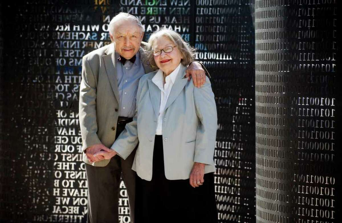 Arthur White and his wife, Vivien White stand in front of the sculpture screen in Whitey Heist Park in Stamford, Conn. on Wednesday June 29, 2011. The couple helped transform the park from a parking lot years ago.