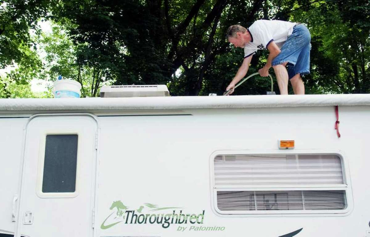 Tom Thompson prepares his Thoroughbred camper for his upcoming trip in Stamford, Conn. on Tuesday June 28, 2011. Thompson and his wife Patty are headed to to Point Folly on Bantam Lake with their grandchildren this summer. The retired Stamford schoolteachers have visited 44 states and 26 national parks.