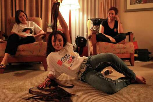 metro - Miss San Antonio Domonique Ramirez dramatically removes her hair extensions as she relaxes in her mother's hotel room in Arlington after the first night of the preliminary competition of the Miss Texas Pageant in the early morning hours of Wednesday, June 29, 2011. Watching are her aunt, Helen Rodgriguez, left, and mother Lorraine Briseno. LISA KRANTZ/lkrantz@express-news.net Photo: LISA KRANTZ, SAN ANTONIO EXPRESS-NEWS / SAN ANTONIO EXPRESS-NEWS