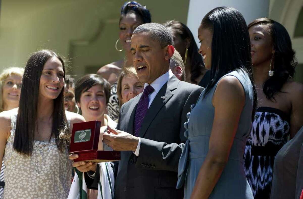 President Barack Obama receives a team ring presented to him by members of the 2010 WNBA Basketball Champion Seattle Storm during a ceremony in the Rose Garden on Wednesday. AFP PHOTO / Saul LOEB