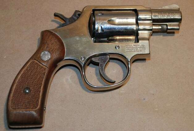 A gun seized during a raid of eight homes in Bridgeport and Stratford early Wednesday morning, arresting 29 suspected gang members in a wide-ranging drug and gun sweep. Photo: Contributed Photo / Connecticut Post Contributed