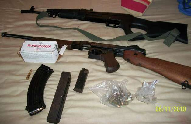 Guns seized during a raid of eight homes in Bridgeport and Stratford early Wednesday morning, arresting 29 suspected gang members in a wide-ranging drug and gun sweep. Photo: Contributed Photo / Connecticut Post Contributed
