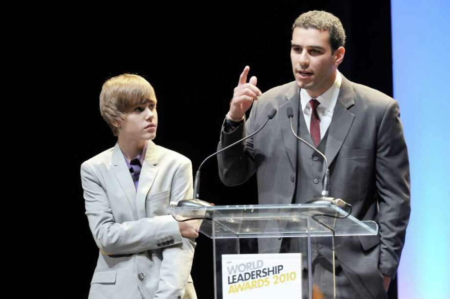 Justin Bieber and Adam Braun at the New Look Foundation's first World Leadership Awards on Aug. 6, 2010, at the Cobb Energy Performing Arts Centre in Atlanta. Greenwich native Adam Braun, whose brother discovered Bieber, founded a nonprofit that builds schools in developing countries. Braun is capitalizing on Bieber-mania and running a contest in which whoever raises the most money for the organization gets to have Bieber perform at their school. Photo: Contributed Photo / Greenwich Time Contributed