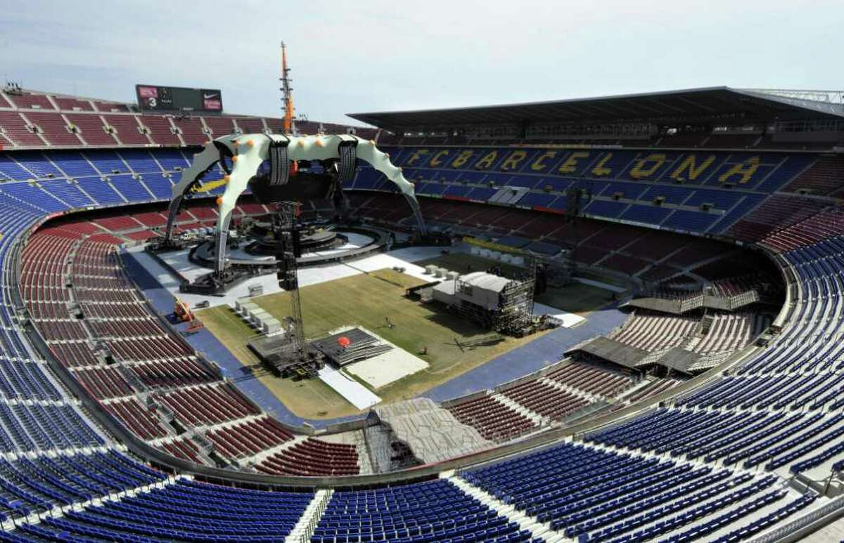 Workers install the stage for the U2 360° Tour concert at Camp Nou stadium in Barcelona on June 26, 2009.