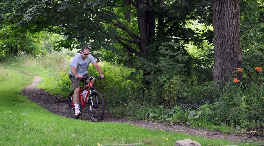 Ian Wilson of Danbury, rides his bike on the trails at Bear Mountain Reserve in Danbury, Wednesday, June 29, 2011. Photo: Carol Kaliff / The News-Times