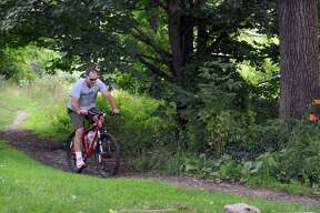 Ian Wilson of Danbury, rides his bike on the trails at Bear Mountain Reserve in Danbury, Wednesday, June 29, 2011.