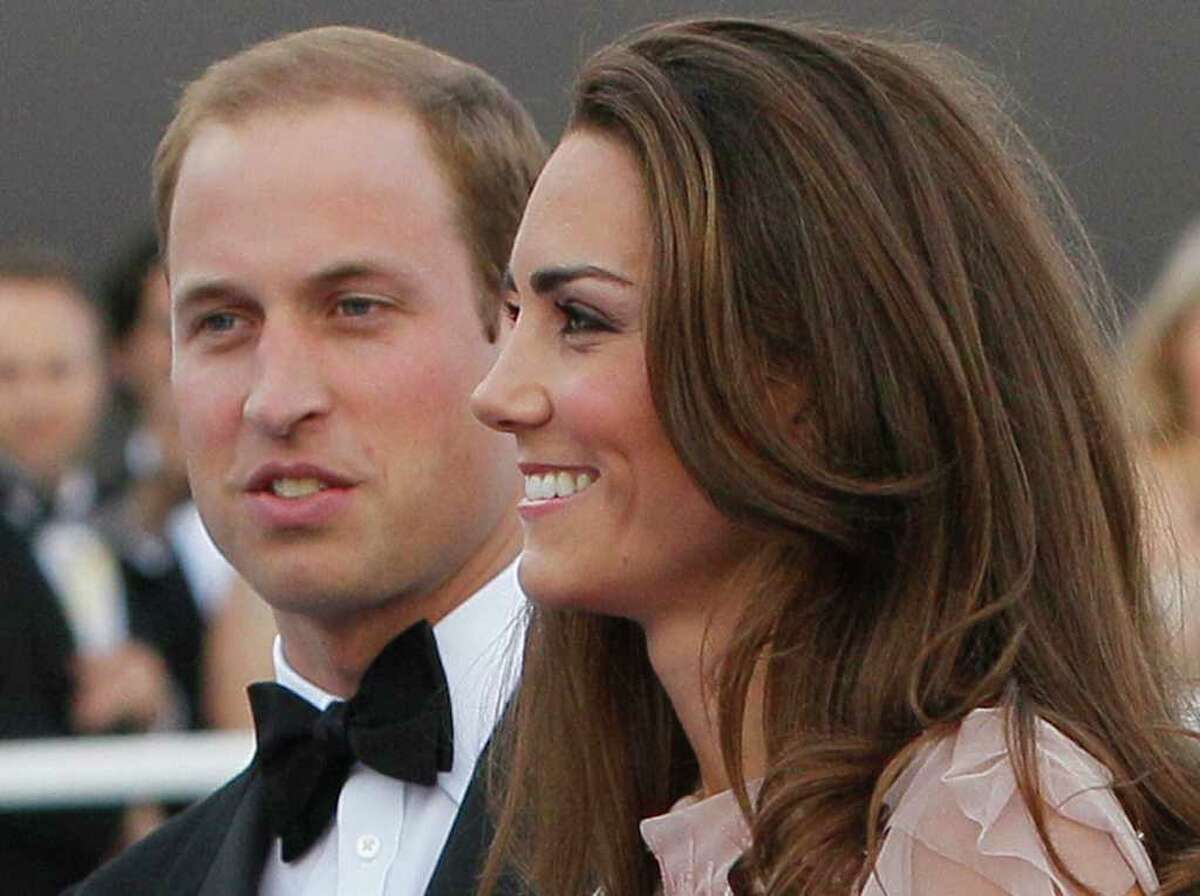 FILE -- Britain's Prince William, the Duke of Cambridge, and his wife Kate, Duchess of Cambridge arrive at a charity event for Absolute Return for Kids, ARK, in London, in this Thursday, June, 9, 2011 file photo. It sounds like a bit of a racket: $4000 for a three-course meal and a chance to see a polo match up close, or $400 for a box lunch and a chance to see the same match from the more distant bleachers. It gets better, however, when you throw in a chance to rub shoulders with the Duke and Duchess of Cambride, especially in southern California, where bragging about having a glass of wine with Prince William and the former Kate Middleton may just be worth the price of a used compact car or a week's vacation. That's what the organizers of a July 9 charity event at the Santa Barbara Polo & Racquet Club are hoping for. The glitzy royal couple makes a guest appearance there at the tail end of a ten-day trip to Canada and southern California that begins on Thursday July 30, 2011, that marks their first overseas trip as man and wife, and the first test of their appeal on the international charity circuit.(AP Photo/Alastair Grant, file)