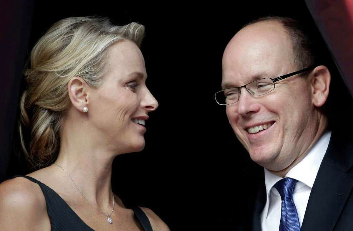 FILE - In this Thursday, June 23, 2011 file photo, Prince Albert II of Monaco and his fiancee Charlene Wittstock attend the St Jean Religious Parade, in Monaco. Charlene Wittstock has not one, but two tough acts to follow. As the future princess of Monaco and wife to longtime bachelor Prince Albert II, the Zimbabwe-born, South Africa-raised former Olympic swimmer is to succeed Grace Kelly, whose 1956 wedding to Prince Rainier III is still widely seen as the gold standard for royal nuptials. And as if the blue-eyed Hollywood beauty-turned-beloved princess didn't cast a long enough shadow, Albert's long-awaited marriage to Wittstock comes on the heels of the royal wedding of the decade, Kate Middleton's union with Britain's Prince William. It's still the biggest thing to hit Monaco since Grace walked down the aisle in an elegant antique lace gown, ushering in a new era of high-wattage glamour into this tiny Riviera principality known for its high-flying casinos and lax tax laws. (AP Photo/Lionel Cironneau, File)
