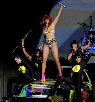 LOS ANGELES, CA - JUNE 28:  Singer Rihanna performs at the Staples Center on June 28, 2011 in Los Angeles, California. Photo: Kevin Winter, Getty Images / 2011 Getty Images
