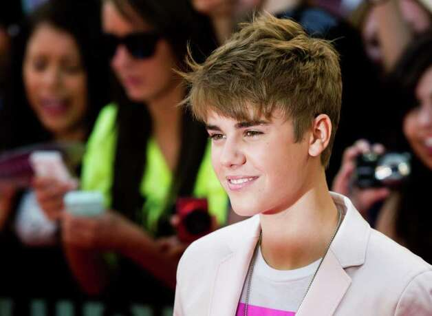 Singer Justin Bieber arrives on the red carpet during the 2011 MuchMusic Video Awards in Toronto on Sunday, June 19, 2011. (AP Photo/The Canadian Press, Darren Calabrese) Photo: AP