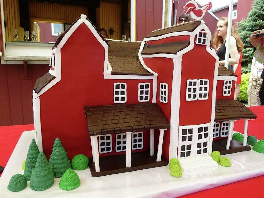 The Westport Country Playhouse -- rendered here in cake form -- was feted on its 80th anniversary Wednesday by officials and the theater community. Photo: Contributed Photo/Mike Lauterborn, Contributed Photo / Westport News contributed