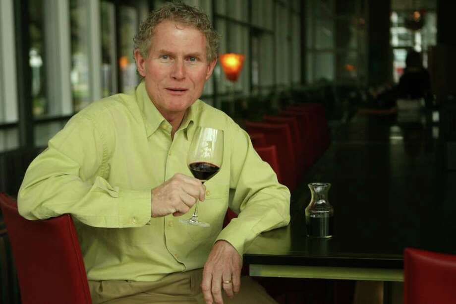 New wine columnist Dale Robertson at Grove restaurant enjoying a favorite bottle of wine on Tuesday, March. 4, 2008 in Houston, TX. Photo by Mayra Beltran / Chronicle Photo: Mayra Beltran / Houston Chronicle