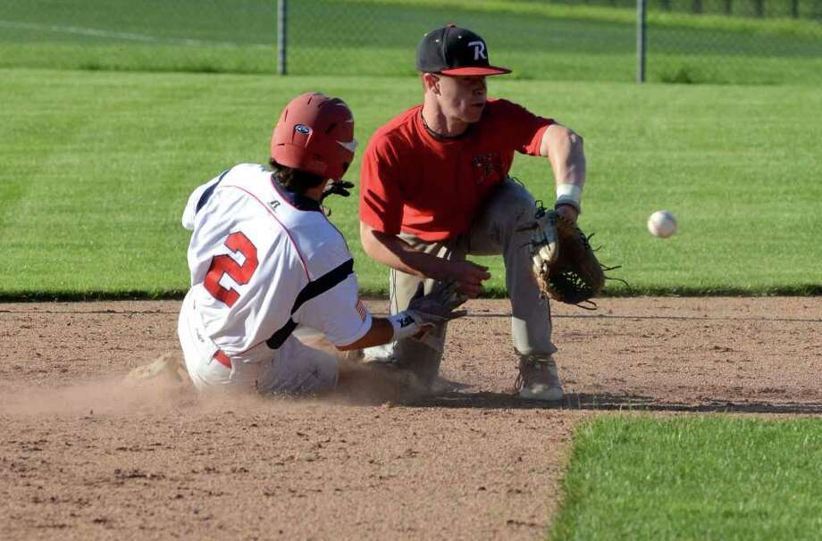Greenwich's Andrew Coffey (2) slides back to second base before the tag as Ridgefield's Bryce Maher (1) waits for the ball during the Senior Legion baseball game at Greenwich High School on Wednesday, June 29, 2011. Photo: Amy Mortensen / Connecticut Post Freelance