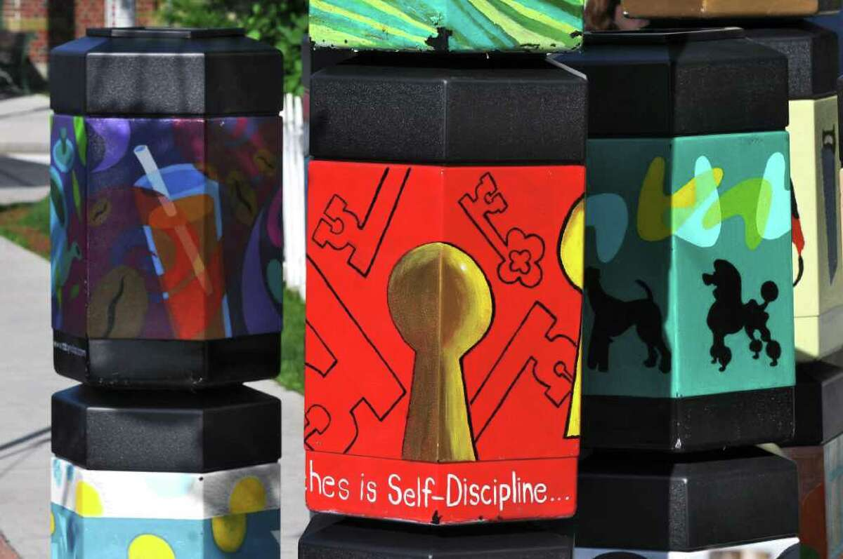 Here are some of the 20 new garbage cans painted by artists and commissioned by the Delaware Avenue Merchants Group in Albany. ( Philip Kamrass / Times Union)