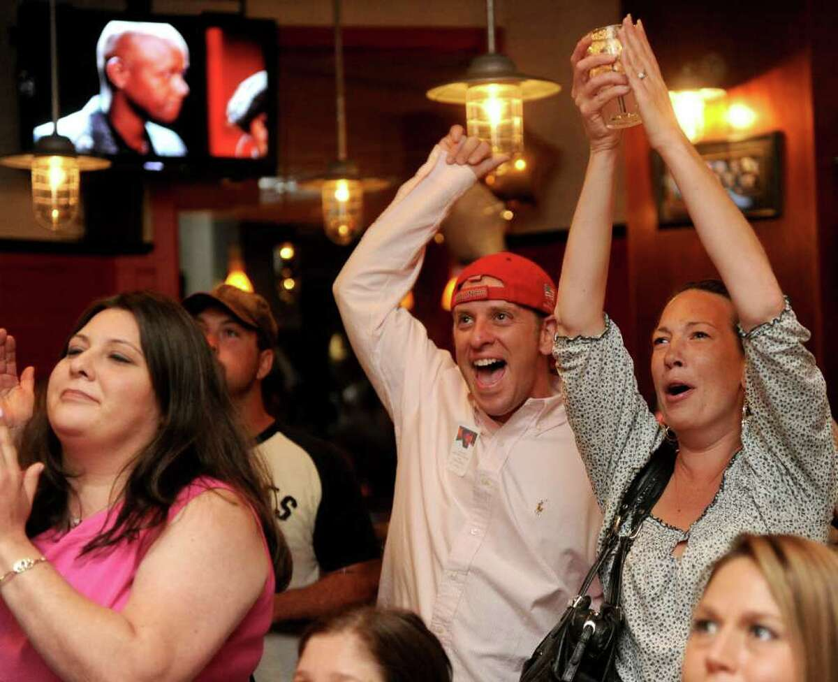 Doug Starratt cheers with friends as Javier Colon is annouced the winner of