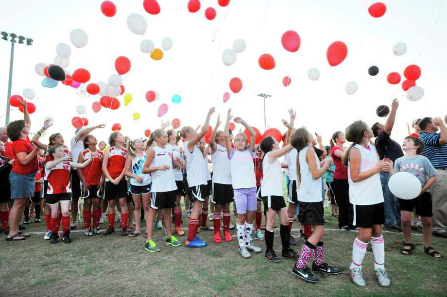Spindletop Select soccer players of all ages and their families release balloons in honor of Dutch soccer legend Jan Van Beveren, who spent the last four-plus years of his life as the Director of Training for Spindletop Select Soccer Club. Tuesday, June 28, 2011.  Valentino Mauricio/The Enterprise Photo: Valentino Mauricio