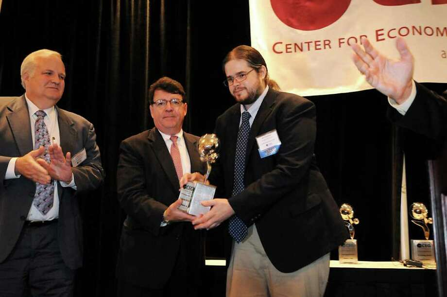 Nick Cosimano, president and CEO of Carma Systems Inc., right, accepts the award for Promising New Start-up from F. Michael Tucker, center, and Jeff Lawrence during the 15th Annual Center for Economic Growth Technology Awards on Wednesday, June 29, 2011, at the Crown Plaza in Albany, N.Y. (Cindy Schultz / Times Union) Photo: Cindy Schultz
