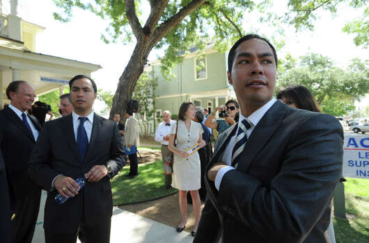 Mayor Julian Castro (right) and his twin brother,  state Rep. Joaquin Castro join others at the opening of the new offices for micro and small business-lender Accion Texas-Louisiana, Accion's Lending and Learning Center, on June 28, 2011. Photo: Billy Calzada / gcalzada@express-news.net