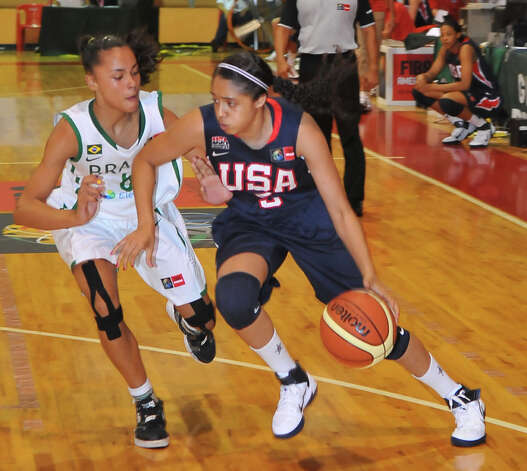 Recee' Caldwell, a 5-foot-8 point guard shown against Brazil, was the youngest on Team USA at the tournament this month in Merida, Mexico. Photo: Courtesy Photo