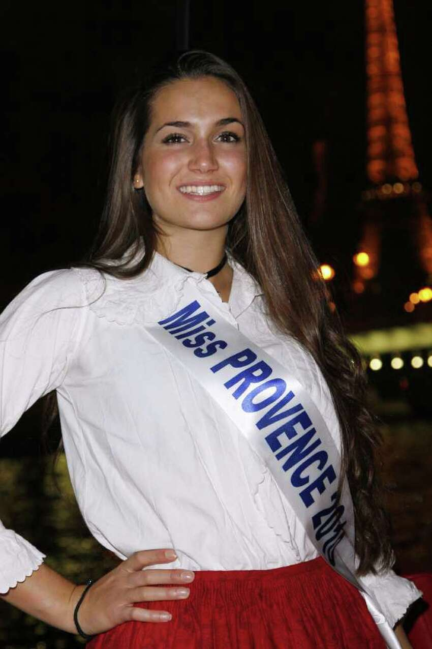 CLICK HERE: TP turning heads in Paris with new girlfriend Miss Provence Barbara Morel poses in a traditional costume during a dinner party organised on a bateau mouche (tourist boat) on the Seine river near the Eiffel Tower on December 03, 2010 in Paris. The 2011