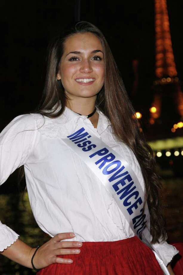 "CLICK HERE: TP turning heads in Paris with new girlfriendMiss Provence Barbara Morel poses in a traditional costume during a dinner party organised on a bateau mouche (tourist boat) on the Seine river near the Eiffel Tower on December 03, 2010 in Paris. The 2011 ""Miss Nationale"" Beauty contest will take place in Paris on December 5, 2010. AFP PHOTO THOMAS SAMSON Photo: THOMAS SAMSON, AFP/Getty Images / 2010 AFP"