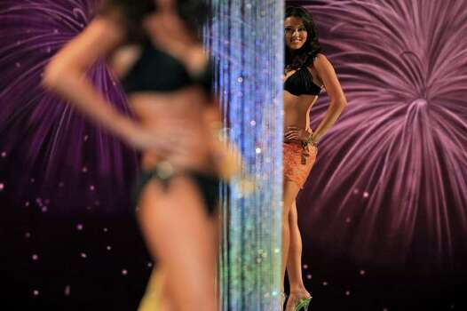 Miss San Antonio Domonique Ramirez, right, waits to walk for the judges during the fitness competition for the second night of the Miss Texas Pageant preliminary competition at Texas Hall on the campus of the University of Texas at Arlington on Wednesday, June 29, 2011. LISA KRANTZ/lkrantz@express-news.net Photo: LISA KRANTZ, SAN ANTONIO EXPRESS-NEWS / SAN ANTONIO EXPRESS-NEWS