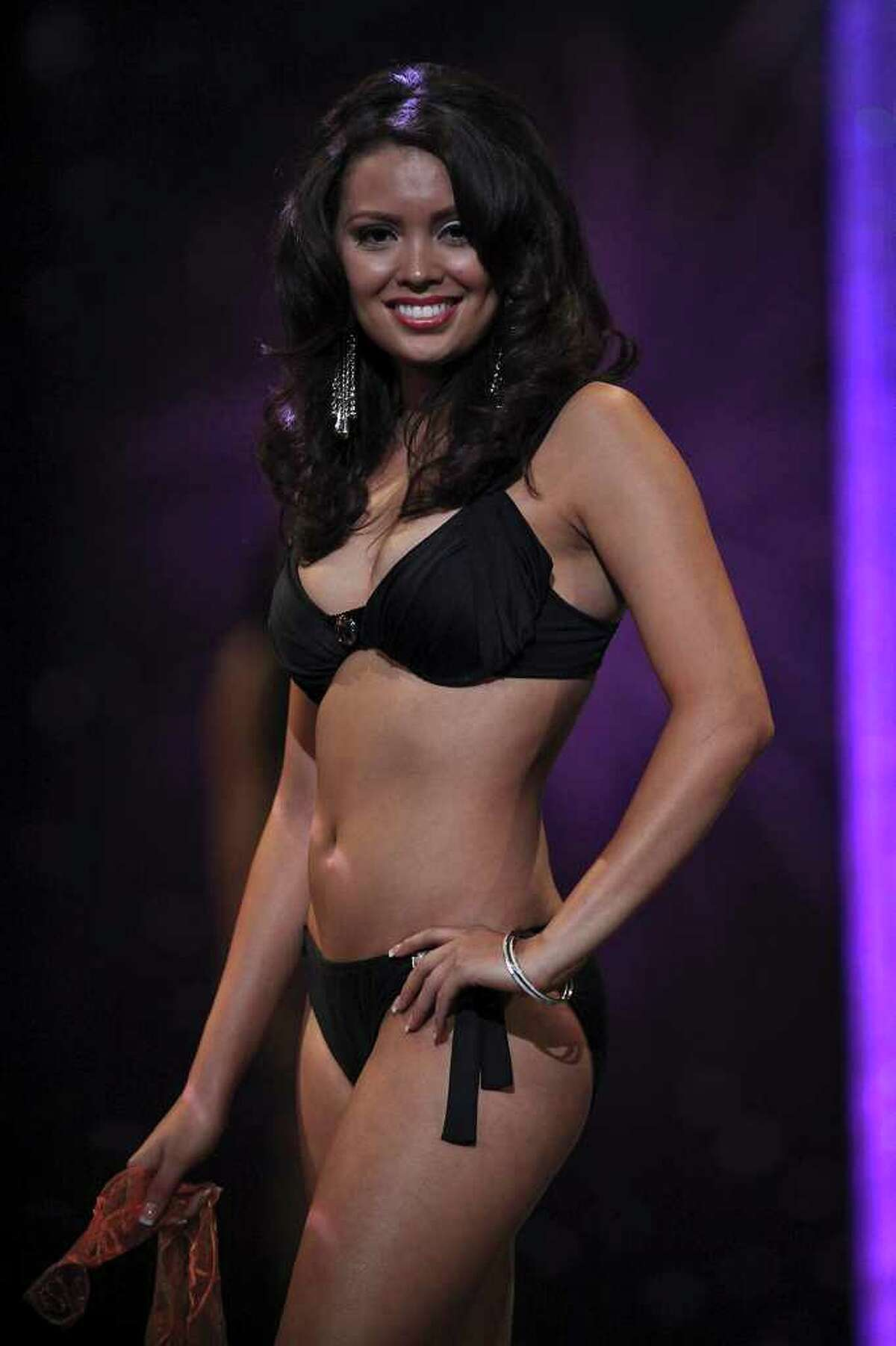 Miss San Antonio Domonique Ramirez, right, walks for the judges during the fitness competition for the second night of the Miss Texas Pageant preliminary competition at Texas Hall on the campus of the University of Texas at Arlington on Wednesday, June 29, 2011. LISA KRANTZ/lkrantz@express-news.net