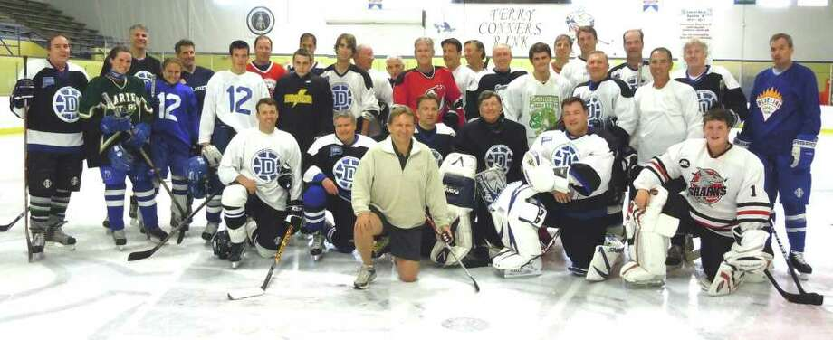 Darien Winter Club members and Charity Skate players take to the ice for the benefit of the Person-to-Person Emergency Assistance Program. Photo: Contributed Photo / Darien News