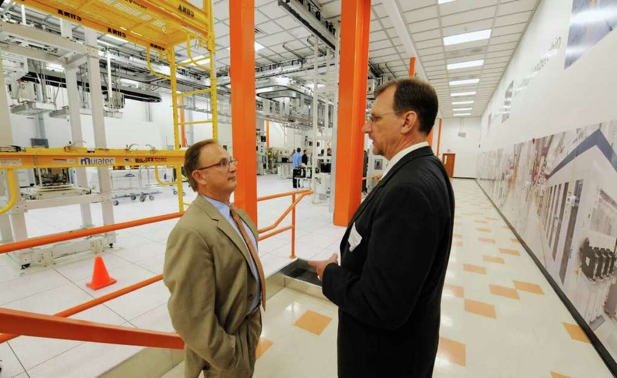 Hudson Valley Community College President Andrew J. Matonak, left speaks with Dave Gross, facilities design and startup manager for Global Foundries, during a tour the ITDC Lab at the Global Foundries offices in Malta, N.Y. June 23, 2011. (Skip Dickstein/ Times Union archive)