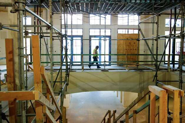 A constuction worker walks through the new Hotel Eilan, a 200,000 sq. ft. hotel with 165 rooms that will be a centerpiece of the Eilan development on June 21, 2011.  Photo by Marvin Pfeiffer Photo: Marvin Pfeiffer/Prime Time Newspapers