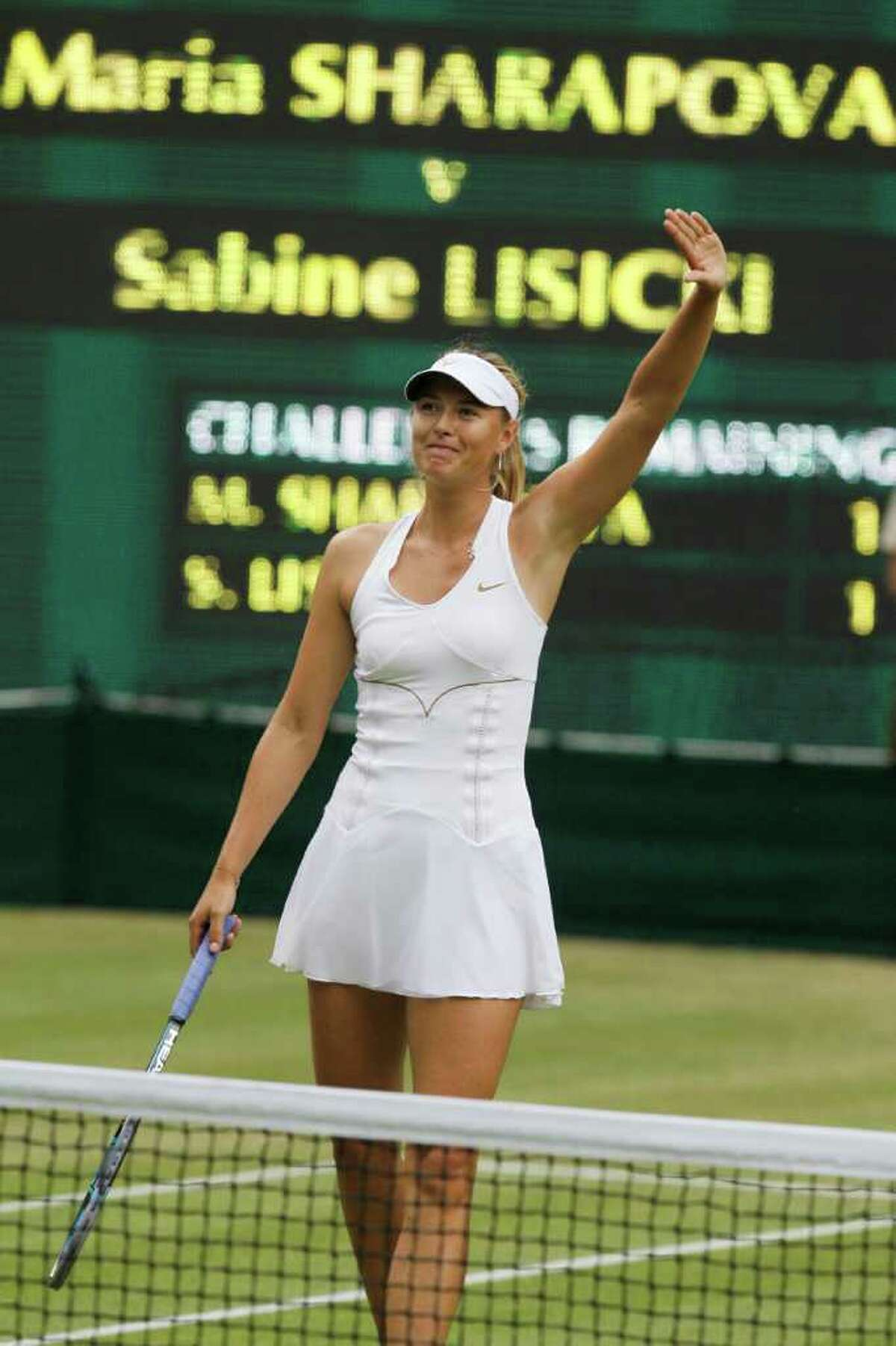 Russia's Maria Sharapova celebrates defeating Germany's Sabine Lisicki in their semifinal match at the All England Lawn Tennis Championships at Wimbledon, Thursday, June 30, 2011.