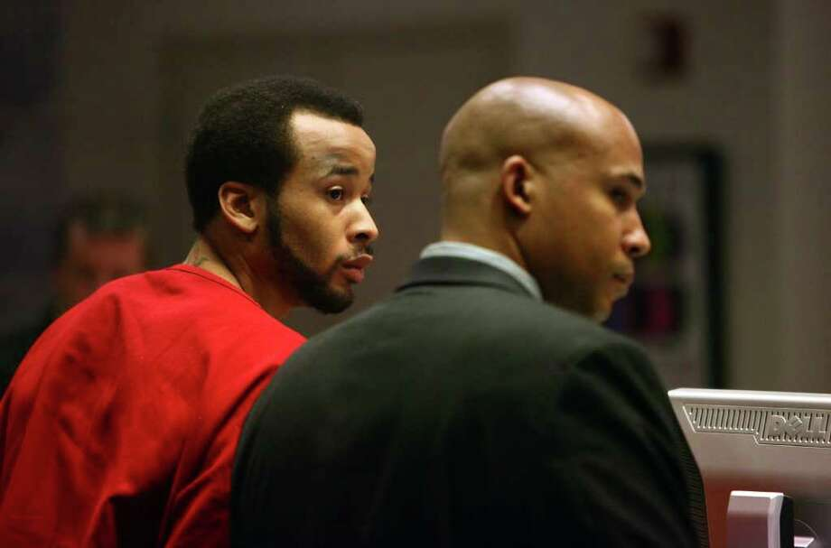 Former University of Washington basketball player Venoy Overton, left, stands in court with his attorney James Bible on Thursday at the Norm Maleng Regional Justice Center in Kent for an arraignment hearing. Overton is charged with promoting prostitution. Bail was set at $25,000. Photo: JOSHUA TRUJILLO / SEATTLEPI.COM