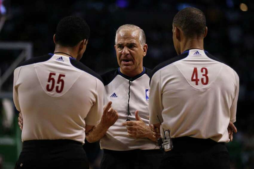 BOSTON - JUNE 08: (L-R) Referees Bill Kennedy #55, Bennett Salvatore and Dan Crawford #43 talk during a stop in play between the Los Angeles Lakers and the Boston Celtics in Game Three of the 2010 NBA Finals on June 8, 2010 at TD Garden in Boston, Massachusetts. NOTE TO USER: User expressly acknowledges and agrees that, by downloading and/or using this Photograph, user is consenting to the terms and conditions of the Getty Images License Agreement. (Photo by Elsa/Getty Images) *** Local Caption *** Bill Kennedy;Dan Crawford;Bennett Salvatore