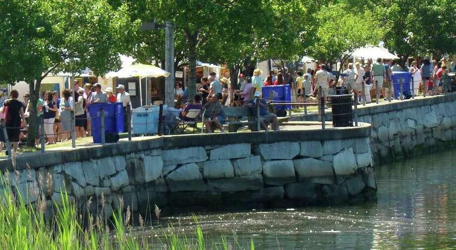 Artists display their works along the Saugatuck River during the 36th annual Westport Arts Festival in 2009. This year's event will attract 145 juried artists to the river's banks. Photo: Contributed Photo