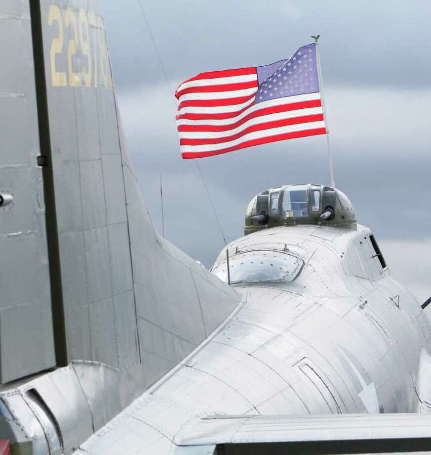 The B-17 is towed from a hangar at Boeing Field to the Museum of Flight on Thursday, June 30, 2011 in Seattle. Photo: JOE DYER / SEATTLEPI.COM