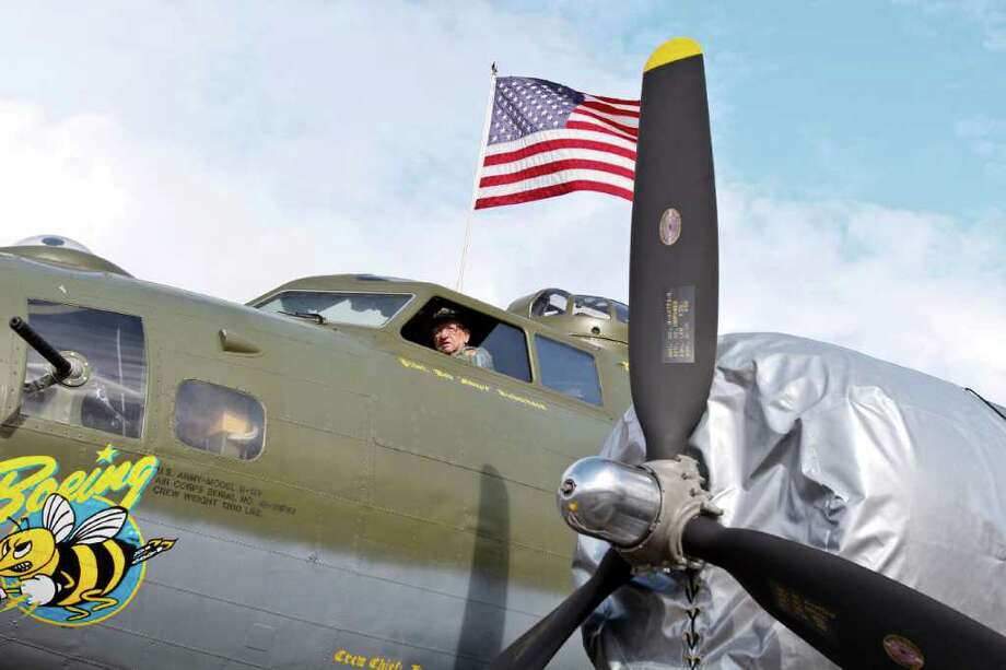Herb Phelan, who has supervised the restoration of the B-17 since 1998, sits in the flight deck as the aircraft is moved into position at the Museum of Flight on  Thursday, June 30, 2011 in Seattle. Photo: JOE DYER / SEATTLEPI.COM