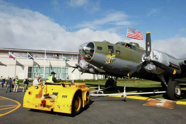 The B-17f is pushed onto the east lawn at the Museum of Flight in /Seattle, Thursday, June 30, 2011 Photo: JOE DYER / SEATTLEPI.COM
