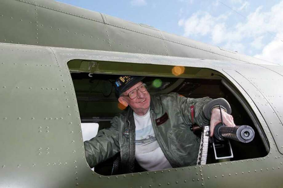 Herb Phelan, who has supervised the restoration since 1998, sits at one of the B-17's 50-caliber machine guns on Thursday, June 30, 2011 in Seattle Photo: JOE DYER / SEATTLEPI.COM