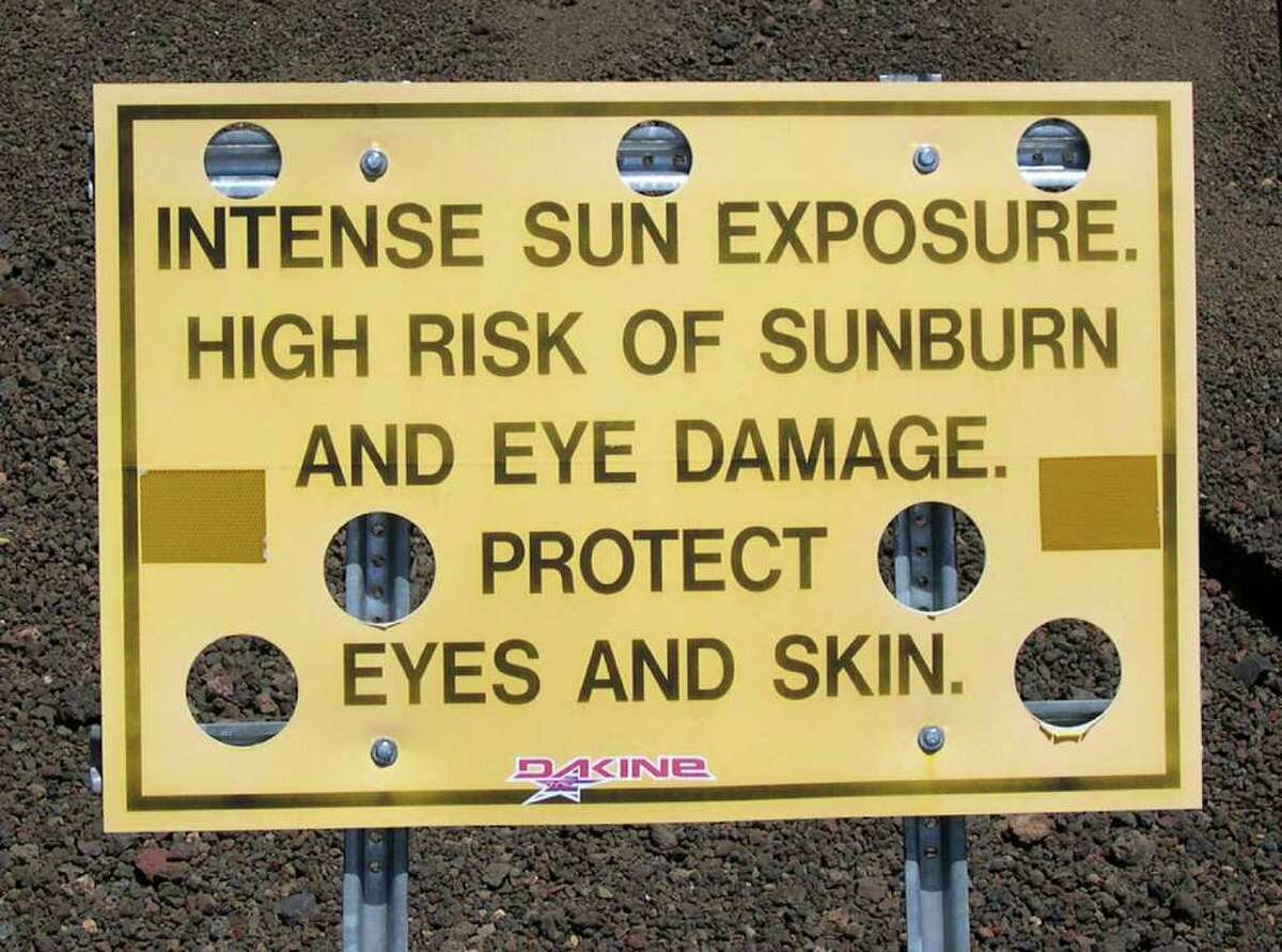 A fluffy cumulus cloud near the sun can cause UV in San Antonio to be nearly as intense as that atop a mountain such as Hawaii's Mauna Kea, where this warning sign was photographed. Photograph by Forrest M. Mims III.