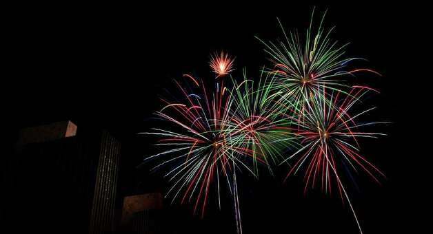 Times Union staff photo by Cindy Schultz -- Fireworks light up the sky during the Fourth of July celebration on Friday, July 4, 2008, at the Empire State Plaza in Albany, N.Y. (WITH STORY) Photo: CINDY SCHULTZ, DG / ALBANY TIMES UNION