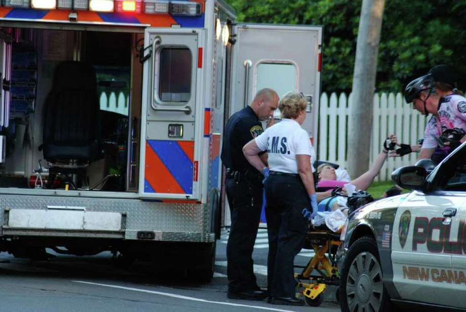 New Canaan Police and EMTs responded to an accident on South Avenue Wednesday at about 7:45 p.m. According to witnesses, a bicyclist collided with a silver Honda at the intersection of Route 106. Photo: Jeanna Petersen Shepard, Freelance Photo / New Canaan News freelance