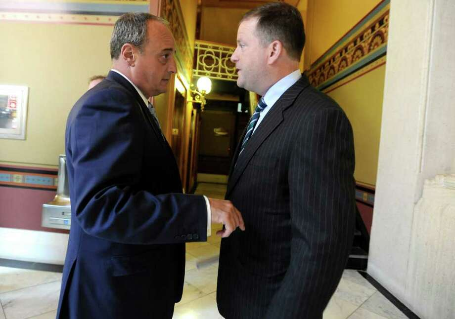 House Minority Leader Larry Cafero, R-Nowalk, left, and Senate Mintority Leader John McKinney, R-Fairfield, speak to one another during special session at the Capitol in Hartford, Conn., Thursday, June 30, 2011.  Connecticut lawmakers returned to the state Capitol on Thursday and are expected to vote on an 11th-hour, tentative compromise reached with Gov. Dannel P. Malloy on balancing the state budget after state employees rejected a labor-savings and concessions deal. (AP Photo/Jessica Hill) Photo: Jessica Hill, AP / AP2011