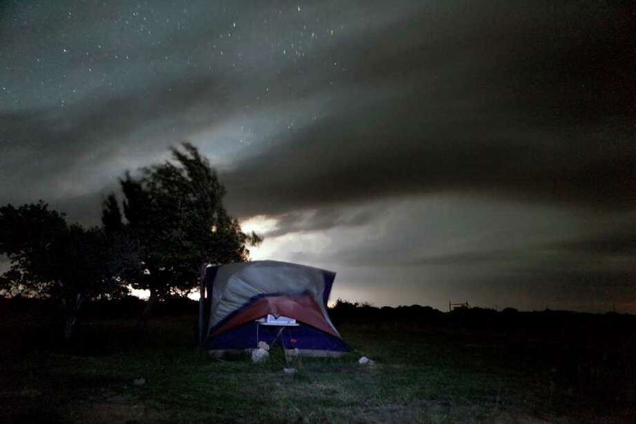 Lightning, storm clouds, and strong North winds buffet the Texas State University archaeology field school late Tuesday night June 21, 2011 in Val Verde County North of Comstock.  Photo: WILLIAM LUTHER, SAN ANTONIO EXPRESS-NEWS / WILLIAM LUTHER
