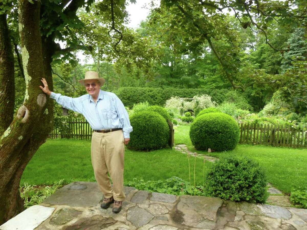 Tom Grant poses on his patio, with his expanded kitchen garden in the background, at his Redding Road property, which took first place in this year's Home Landscaping category of the Pride in Our Homes Contest sponsored by the Greater Fairfield Board of Realtors.